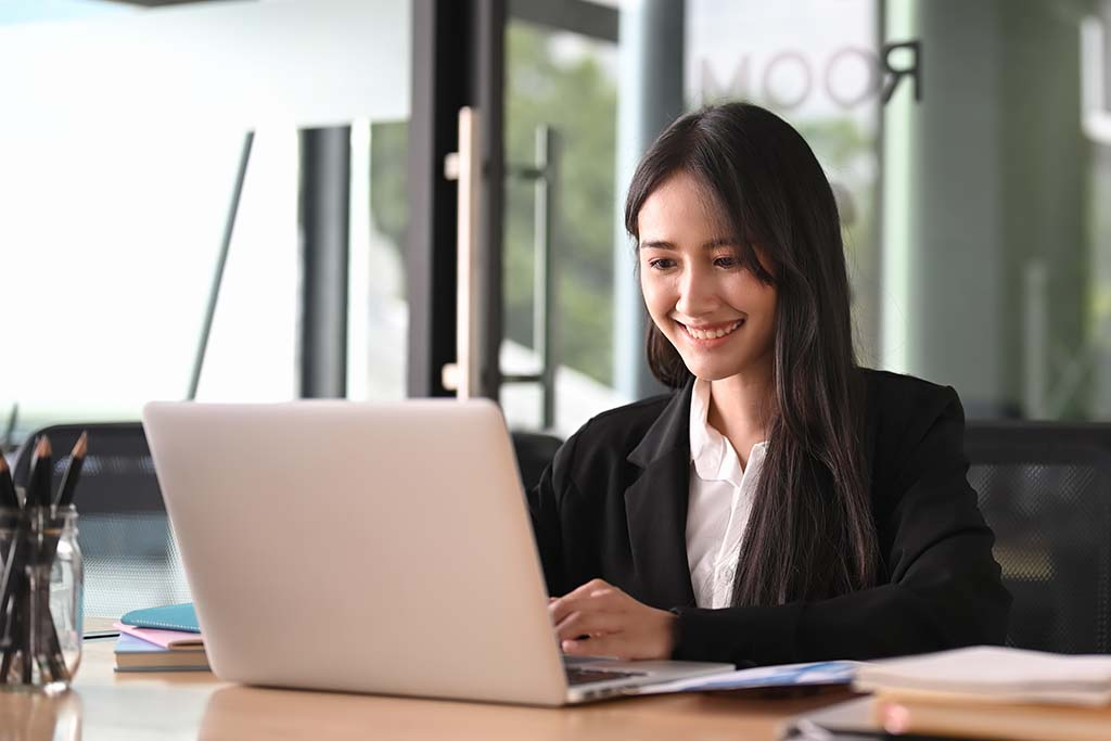 IT specialist smiling while working on computer